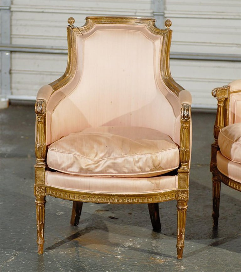 Pair of 19th-20th century Louis XVI style giltwood bergère chairs.