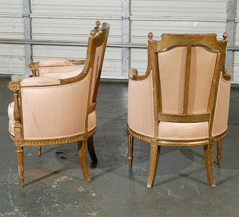 Pair of 20th Century Louis XVI Style Giltwood Bergère Chairs For Sale 1