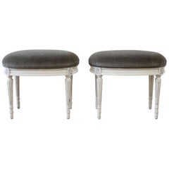 Pair of 20th Century Louis XVI Style Painted and Velvet Upholstered Ottomans