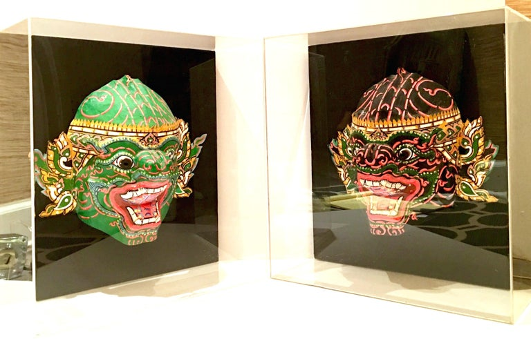 Asian Pair Of 20th Century Lucite Shadow Box Mounted Hand-Painted Tribal Masks For Sale