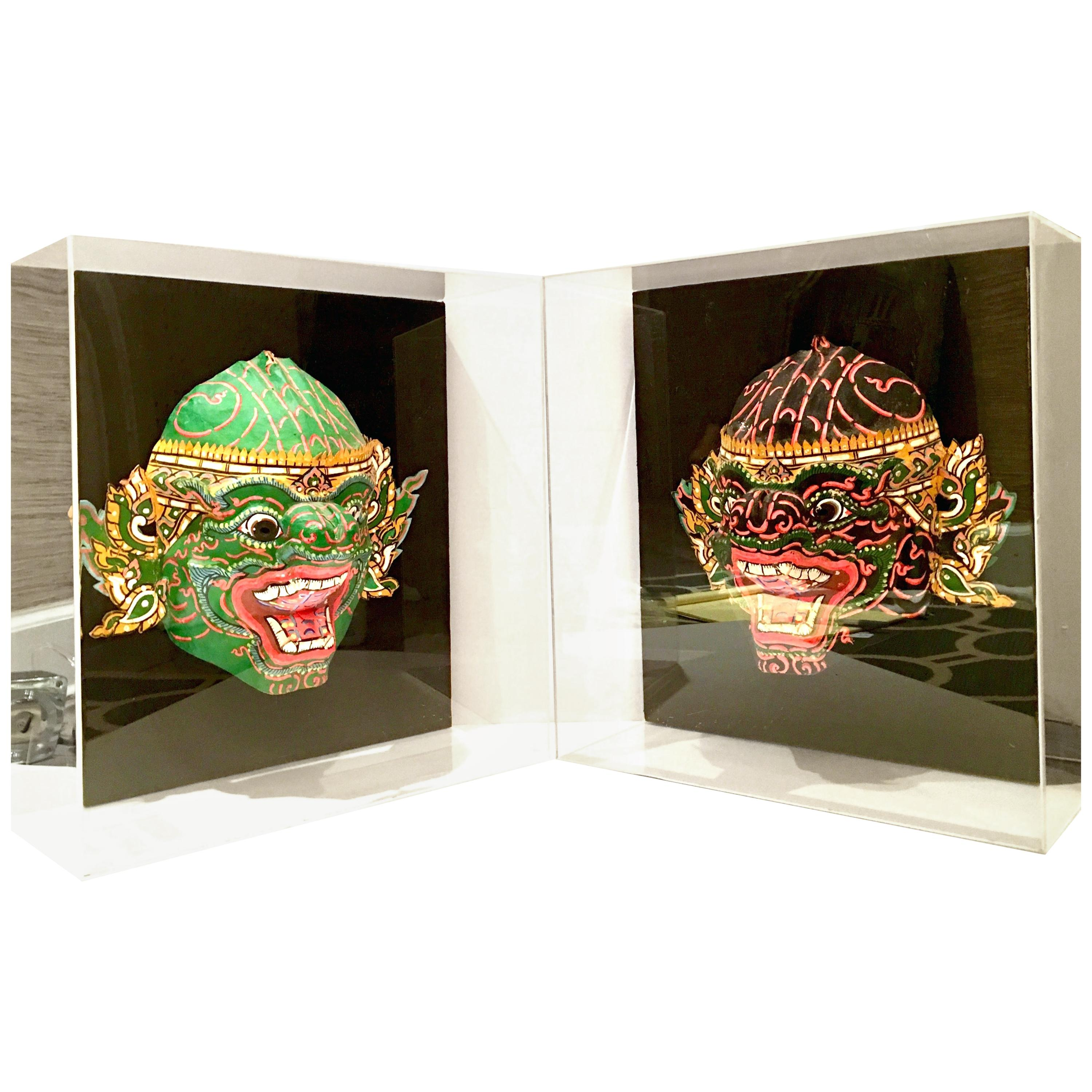 Pair of 20th Century Lucite Shadow Box Mounted Hand Painted Tribal Masks