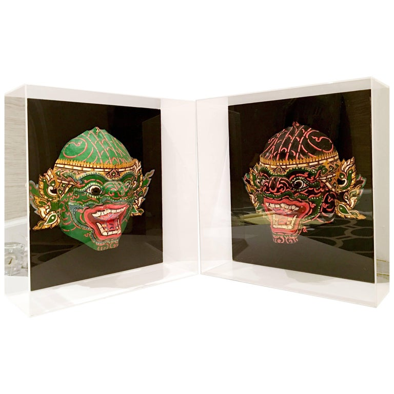 Pair Of 20th Century Lucite Shadow Box Mounted Hand-Painted Tribal Masks For Sale
