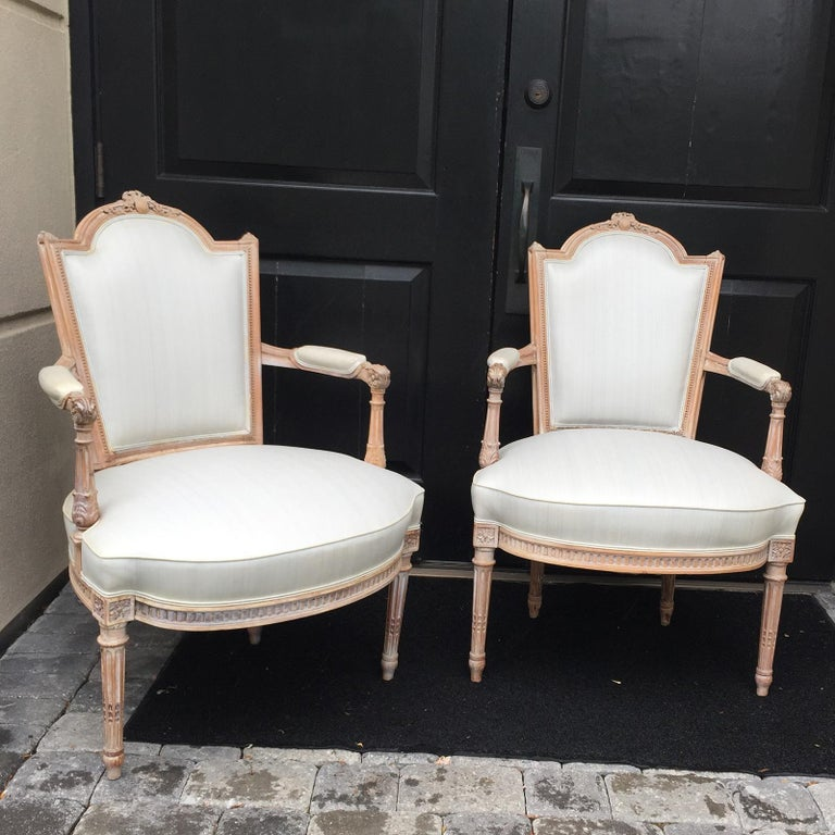 Pair of 20th century neoclassical Louis XVI style open armchairs Measures: Seat height 17