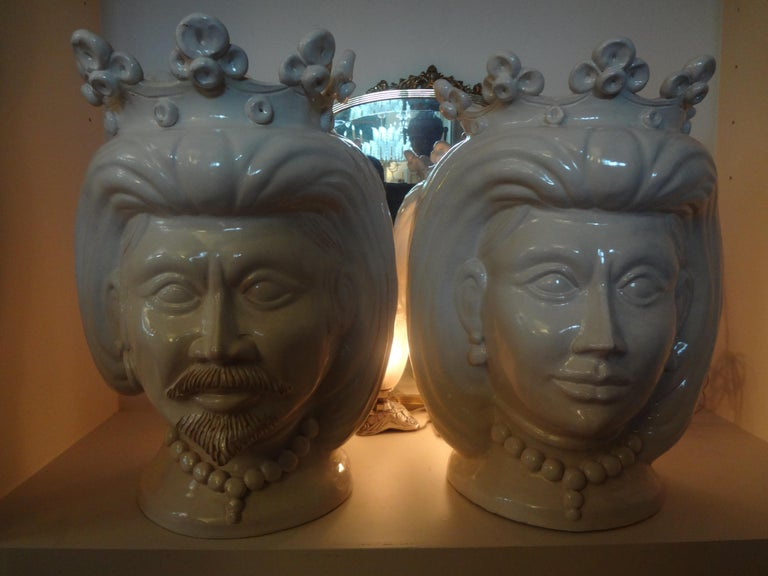 Exceptionally large pair of 20th century Italian white glazed terracotta busts, head jardinières, planters, one a woman, the other a man. This stunning pair of sculptures are both signed F. Boria Caltagirone, a well-established company Sicilian