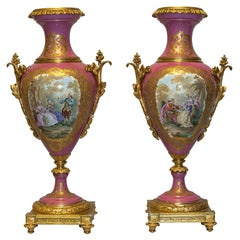 Pair of 20th Century Ormolu Mounted Sèvres Style Porcelain Pink-Ground Vases