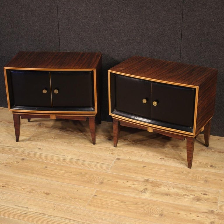 Pair of Italian design bedside tables from the 1960s. Palisander, exotic and ebonized wood furniture of beautiful lines and pleasant decor. Bedside tables of good size and proportion, with two doors, equipped with two internal compartments (see