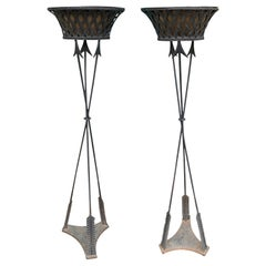 Pair of 20th Century Regency Style Iron Torcheres/Plant Stands with Arrow Motif