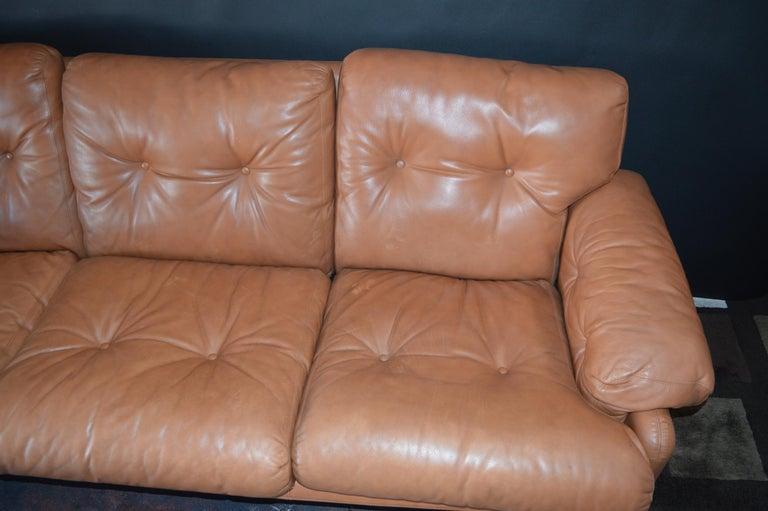 Pair of 20th century Tobia Scarpa Coronado sofa by B&B Italia with tan leather upholstery.