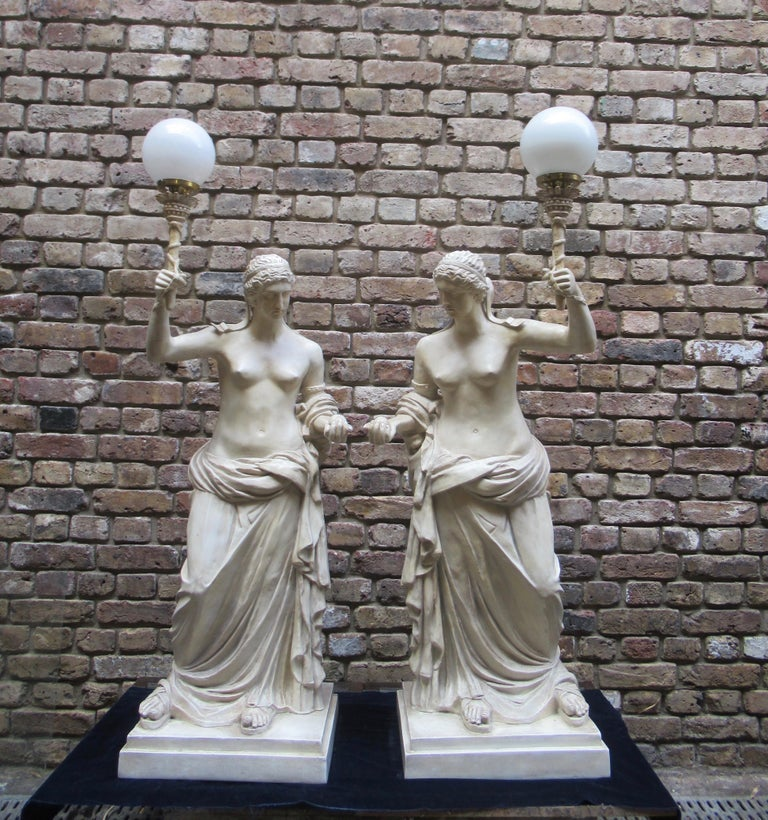 Pair of 20th century vintage Christopher Wray plaster figural lamps depicting Roman women, signed by artist. M. Osman.