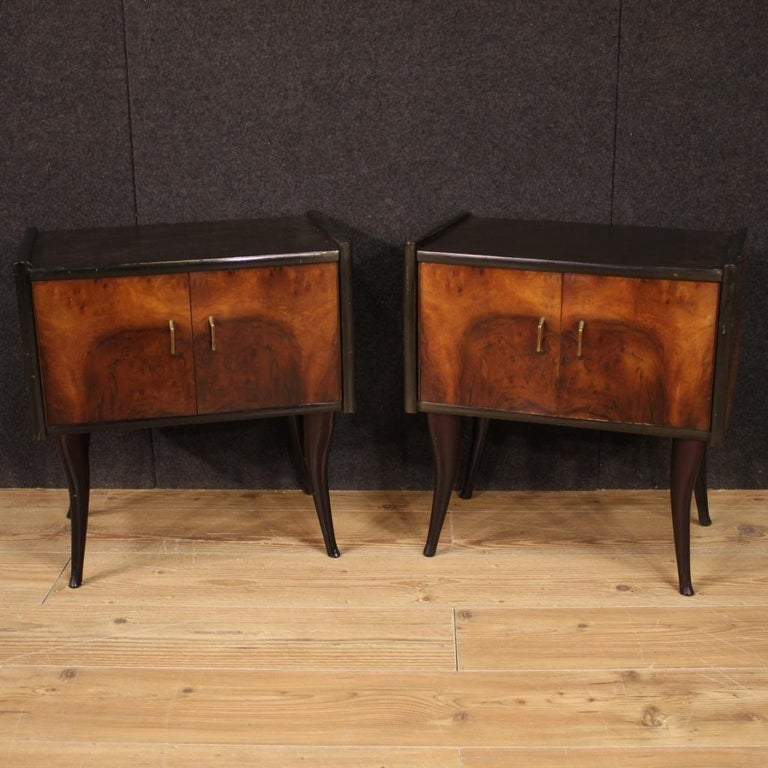 Pair of Italian design bedside tables from the 1960s-1970s. Walnut and ebonized wood furniture of beautiful lines and pleasant decor. Night stands with two doors and wooden top of fair size and service. Ideal furniture to be placed in a bedroom or