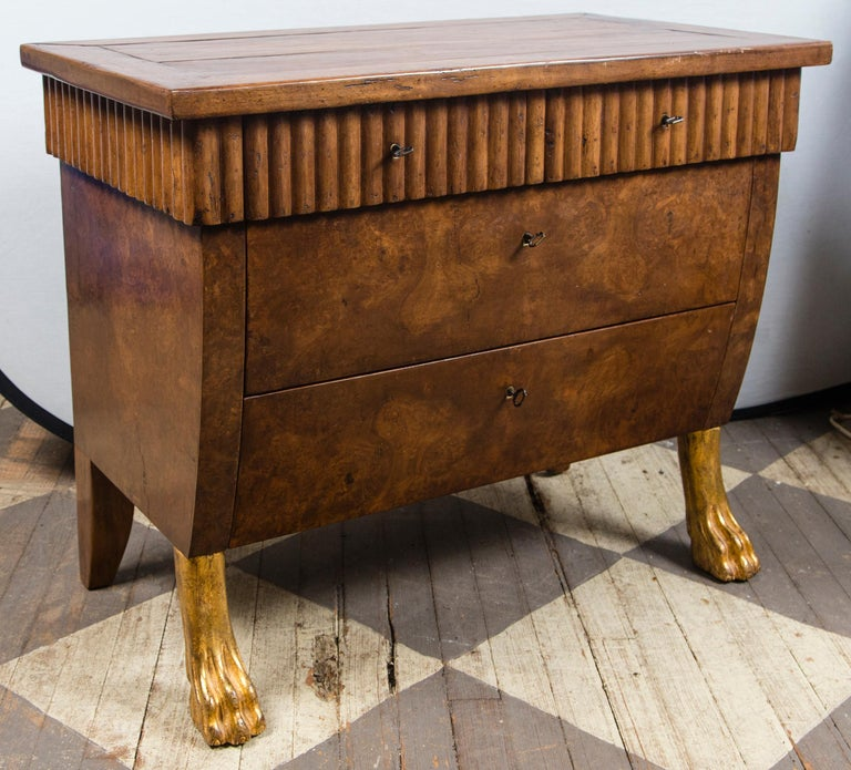 By repute, by William Switzer. They have ribbed apron around the 3 side exteriors. Above the drawers. There are 2 short drawers above 2 long drawers. Burl walnut drawer fronts and sides. The front feet are gilt paws, which extend about 4 inches from