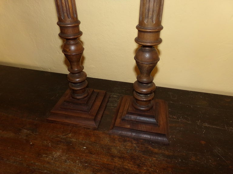 A super pair of turned, carved and fluted pricket walnut candlesticks in the Louis XVI style beautifully crafted from original circa 1890s wood turnings. Our craftsman has retained all the original patination. A beautiful holiday gift for all the
