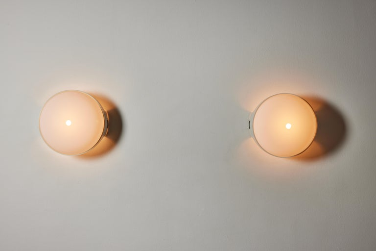 Pair of 4332 wall/ceiling lights by Gian Emilio, Piero & Anna Monti for Kartell. Designed and manufactured in Italy, 1966. Resin, acrylic. Rewired for U.S. standards. We recommend one E27 60w maximum bulb per fixture. Bulbs provided as a one time