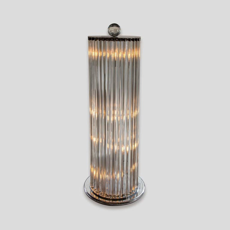 """A pair of very impressive and beautiful floor lamps column shaped , tall clear glass components """" TRIEDRI """" on a chromed metal base and top. Italian design circa 1970. Murano clear blown glass. Absolutely chic, charming and timeless."""
