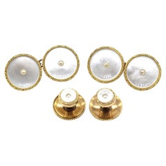 Pair of 9 kt Gold Rimmed Mother of Pearl Cufflinks with Two Dress Studs