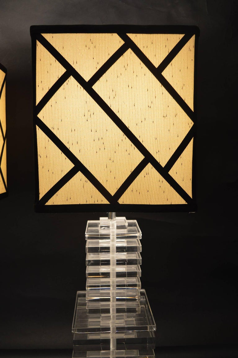 Pair of stacked acrylic lamps.
