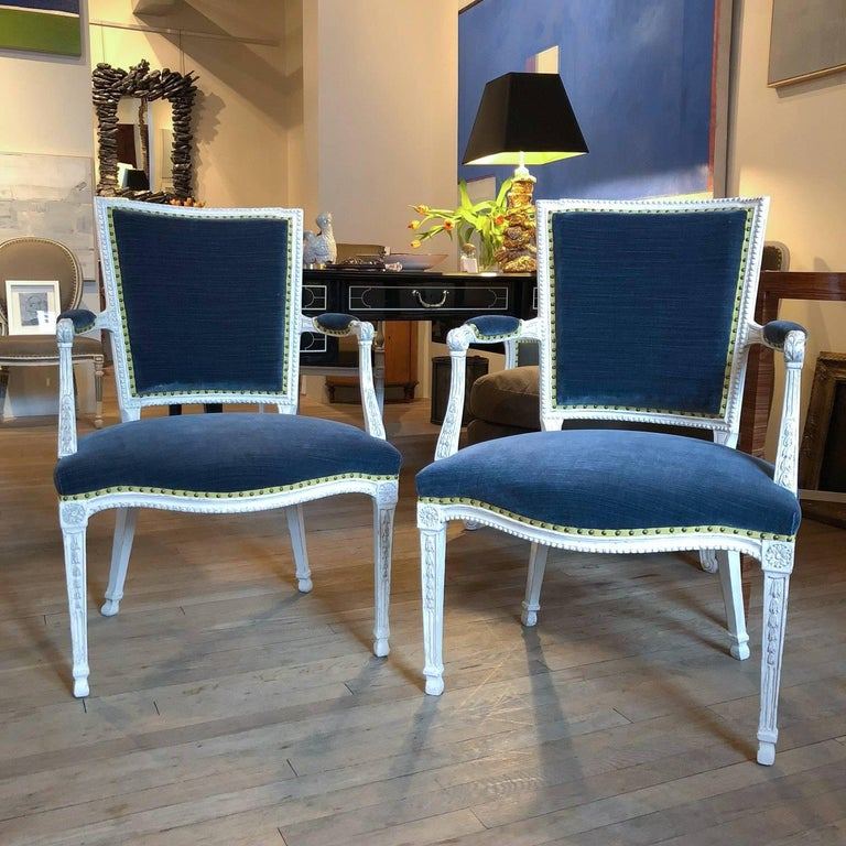 Pair of Adam Gessoed armchairs English, circa 1790 Now upholstered with blue cotton velvet, grosgrain ribbon and French nailhead.