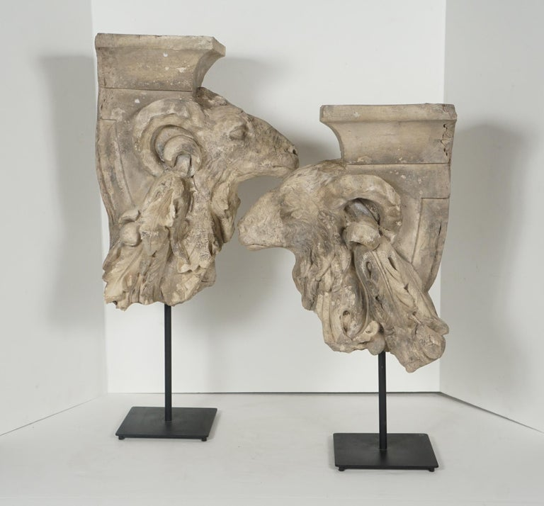 This pair of rams heads set with swags issuing from their horns are French and from the reign of Louis XVI, circa 1780. Following in the neoclassical style prominent at the time this pair of heads made of terracotta are well modeled and show fur and