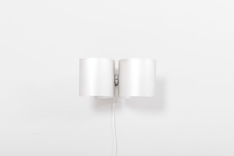 Pair of wall lamps with adjustable lamp shades. Designed in 1960s by Nucleo and manufactured by Sormani in Italy. Made of aluminum and in good vintage condition.  2 x E14 / each.  Please note: Lamp should be fitted professionally in accordance