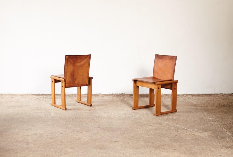 A superb pair of Afra & Tobia Scarpa dining chairs for Molteni, Italy, 1970s. A wonderful and perfect patina to the leather. Fast shipping worldwide.     UK customers please note:    displayed prices do not include VAT.          Please note: Prices