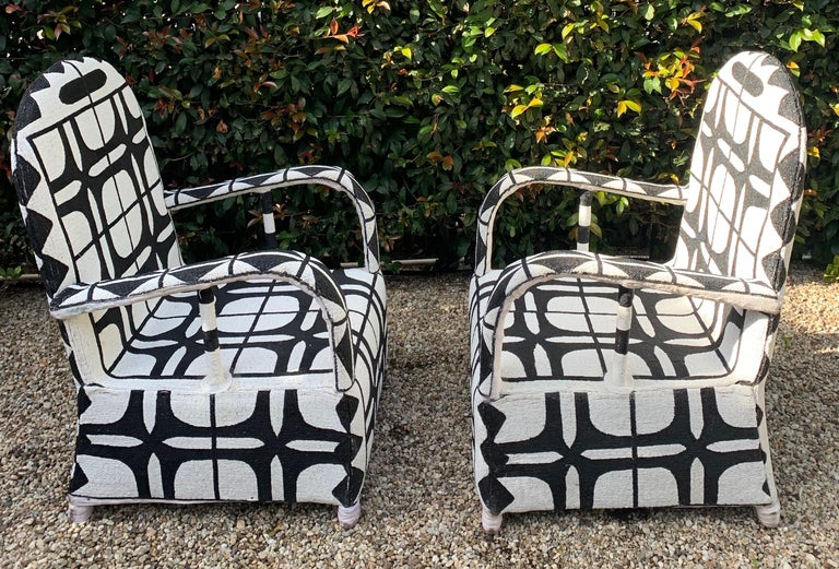 A Pair of handmade / beaded ceremonial Chairs. The chairs, made in Nigeria are custom and made with glass black and white beads to form the exquisite and very graphic pattern. A wonderful pair perfectly represented in many decors, modern or