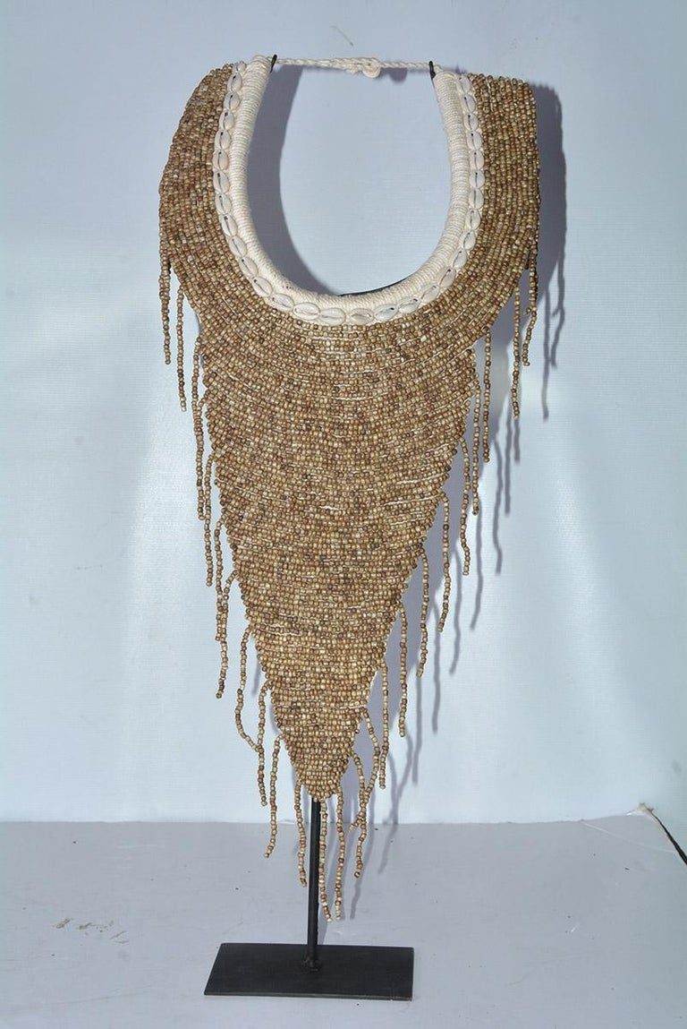 Beaded Pair of African Bib Necklace on Metal Stands For Sale
