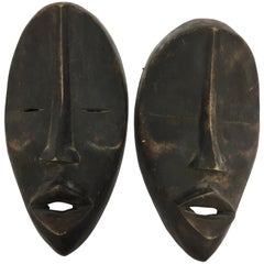 Pair of African Mid-Century Modernist Decorative Man and Woman Masks Sculptures