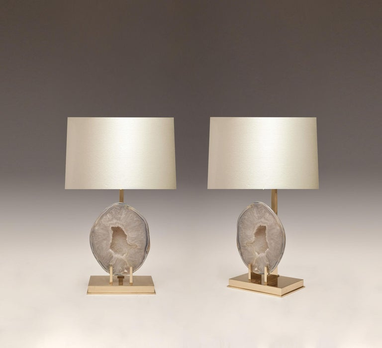Pair of rare natural agate mounts as lamps with custom polished brass base.