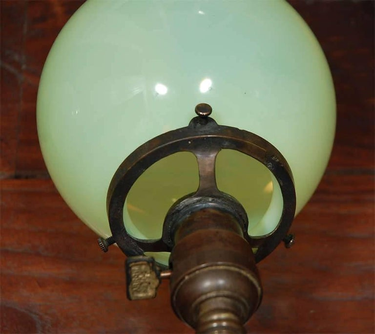 American Pair of Aged Brass Sconces with Vaseline Glass Globes 'Triple' For Sale