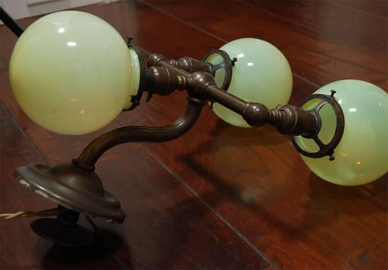 Pair of Aged Brass Sconces with Vaseline Glass Globes 'Triple' For Sale 1
