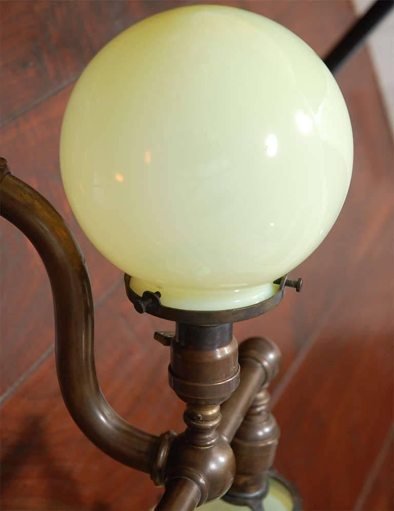 Pair of Aged Brass Sconces with Vaseline Glass Globes 'Triple' For Sale 3
