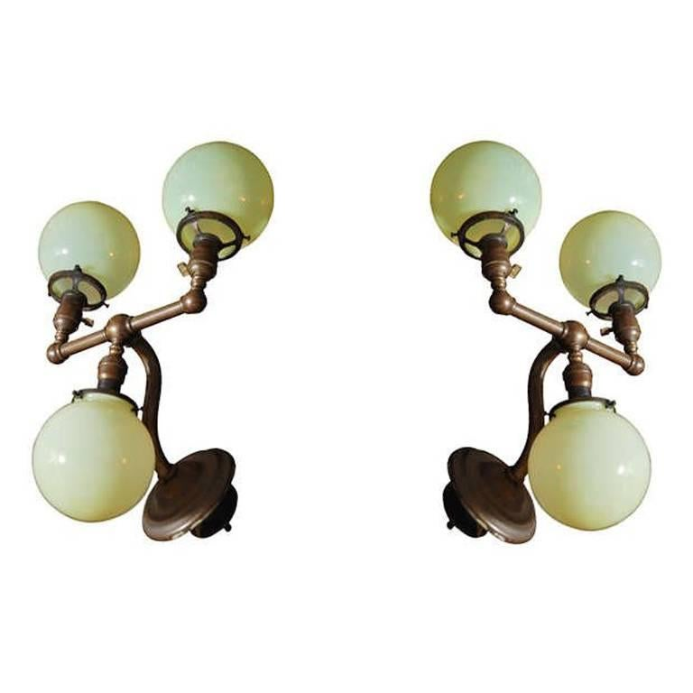 Pair of Aged Brass Sconces with Vaseline Glass Globes 'Triple' For Sale