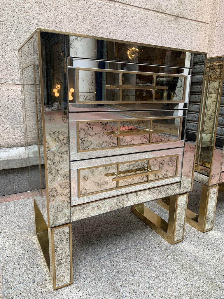 Pair of aged mirror bedside tables Italian work, circa 1980  3 drawers  Dimensions: 54 x 31 x H 70.