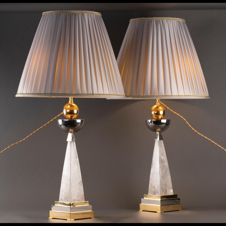 Pair of Aiko 1 model of rock crystal and brass (chrome and 24-karat gold plated)