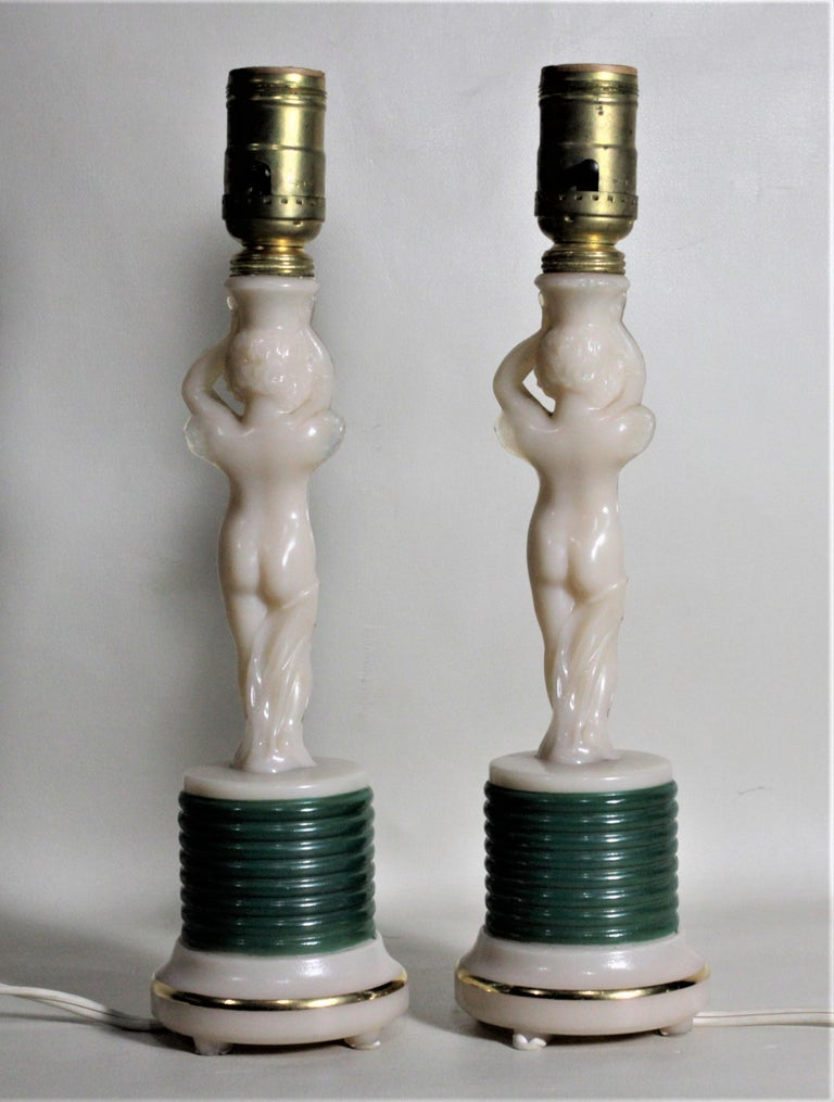 20th Century Pair of Aladdin Art Deco Figural Winged Cherub Glass Table or Boudoir Lamps For Sale