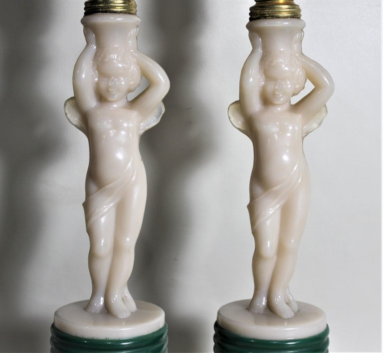 Metal Pair of Aladdin Art Deco Figural Winged Cherub Glass Table or Boudoir Lamps For Sale