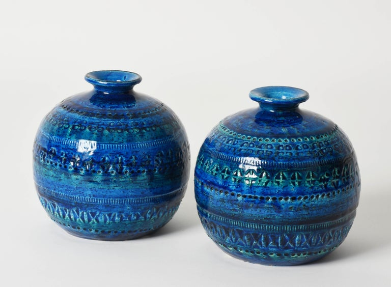Pair of sphere-shaped terracotta ceramic Rimini blue vases for Bitossi. This magnificent set was designed by Aldo Londi in Italy during 1960s.  These pieces are wonderful thanks to the blue, green and turquoise terracotta ceramic glazed by hand