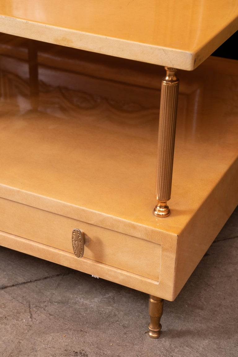 Pair of Aldo Tura dyed yellow goatskin highly lacquered tables.