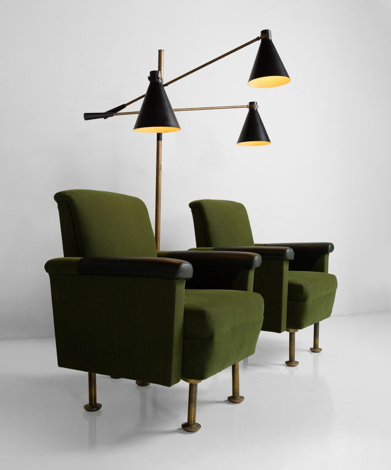 Designed by Alvar Aalto for the Stora Enso headquarters in Finland. Original dark green upholstery, with leather armrests and brass legs.