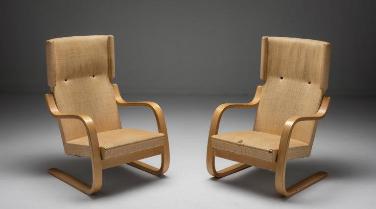 "Pair of Alvar Aalto cantilevered armchairs, Finland circa 1930.  A pre-Artek 401 padded armchair, designed by Alvar Aalto for the Paimio Sanatorium.  Measures: 24.5"" W x 33"" D x 35.5"" H 15.5"" seat."