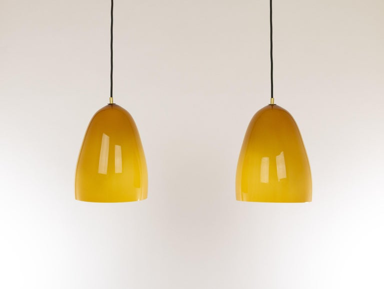 Hand-blown glass amber Model 011.8pendants designed by Massimo Vignelli at the start of his impressive career in design and produced by Murano glass specialist Venini.