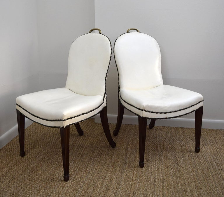 These over-scaled chairs were said to have been designed by Chicago architect Sam Marx, but they were probably made by William Quigley, whose workshop and showroom supplied him with furniture. The sweeping lines of the back and seat, the white