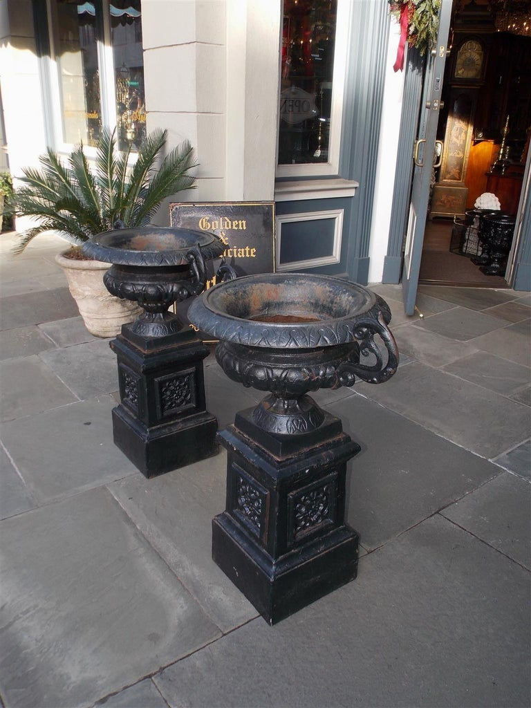 Late 19th Century Pair of American Cast Iron Campana-Form Floral Garden Urns on Plinths Circa 1890 For Sale