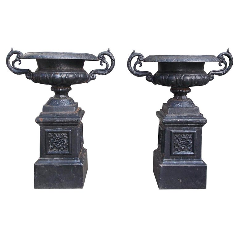 Pair of American Cast Iron Campana-Form Floral Garden Urns on Plinths Circa 1890 For Sale