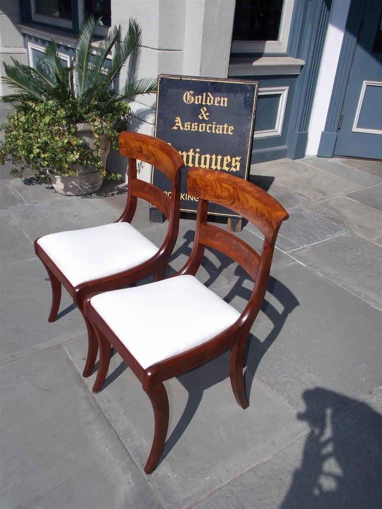 Hand-Carved Pair of American Federal Mahogany Upholstered Side Chairs on Saber Legs, C. 1820 For Sale