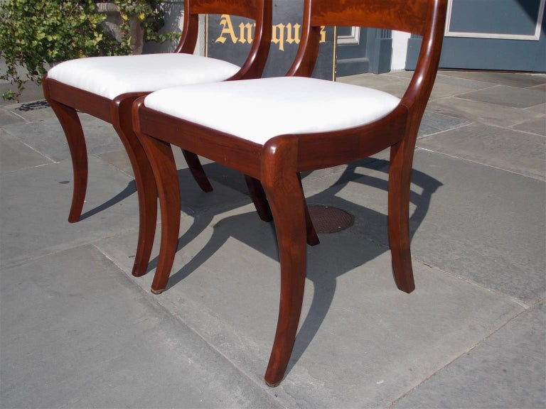 Muslin Pair of American Federal Mahogany Upholstered Side Chairs on Saber Legs, C. 1820 For Sale