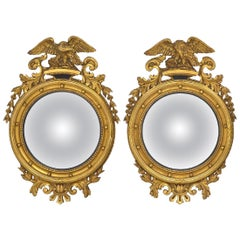 American Federal Style Round Convex Giltwood Mirrors with Opposing Eagles, Pair