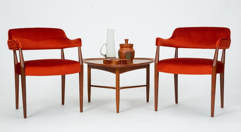 A pair of armchairs by New-York based contract furniture brand J.G. Furniture Co. with walnut frames and Vermillion mohair upholstery. Each chair has a sculpted backrest with tight upholstery and a generously padded seat cushion on matching fabric.