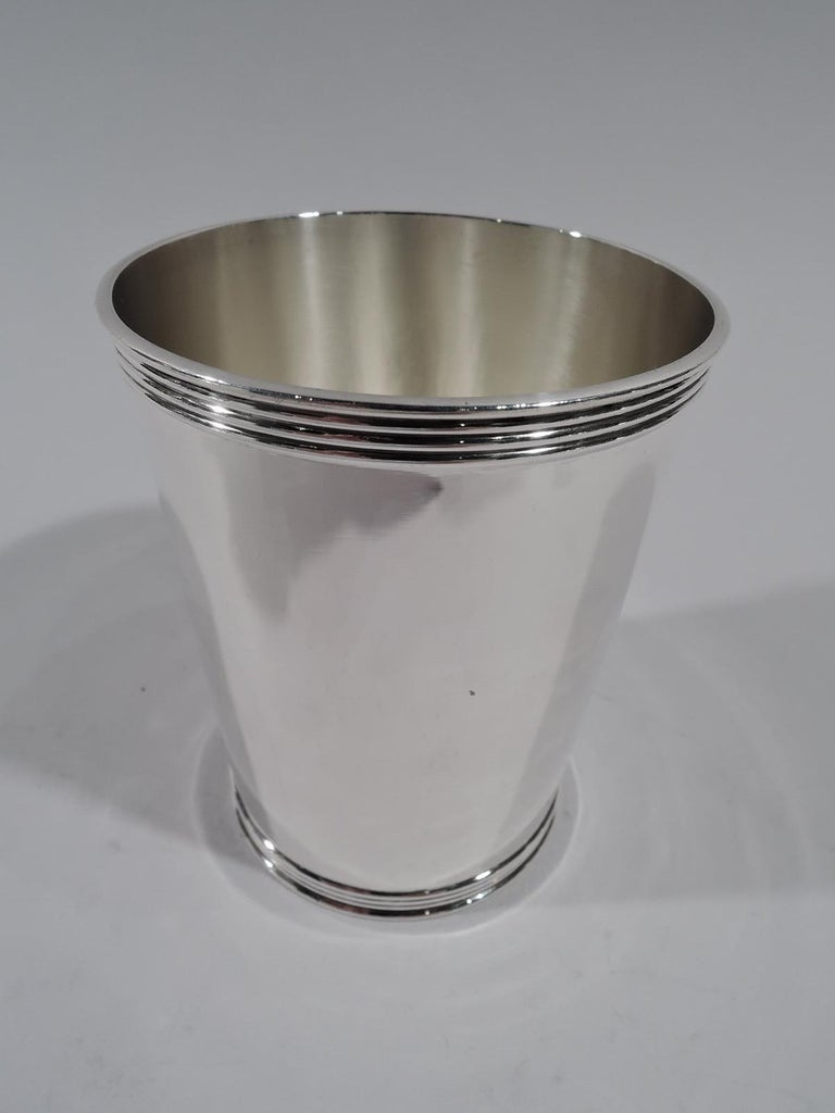 Pair of sterling silver mint julep cups. Made by Frank W. Smith in Gardner, Mass. Each: Straight and tapering sides, and reeded rim and foot. Fully marked including maker's initial S and no. 3759. Total weight: 7.5 troy ounces.