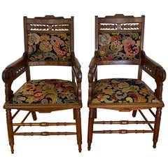 Pair of American Victorian Carved Walnut and Needlepoint Upholstered Armchairs